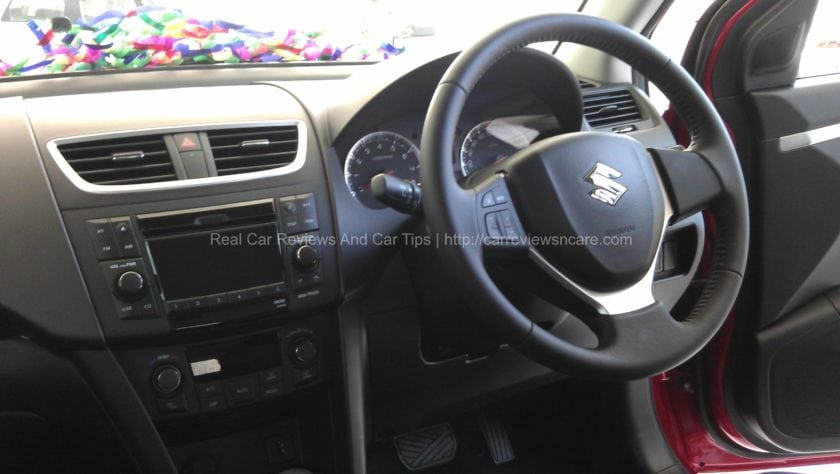 Suzuki Swift 1.4 CBU Dual tones colours on dashboard with digital display for audio and air-con information