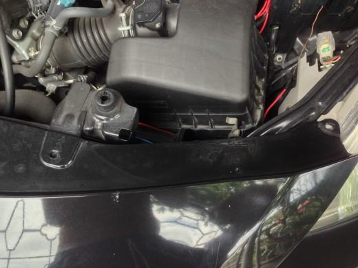 Remove 4 pins at the Toyota Vios Top Bumper