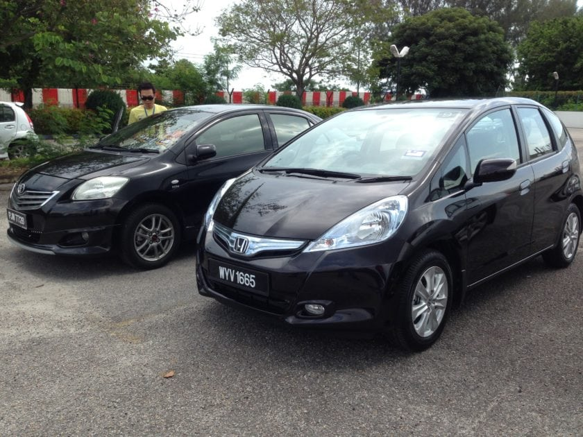 Honda Jazz Hybrid is beside Toyota Vios