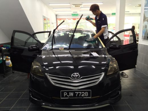 The staffs are installing the Raytech Ultra 70 on the Toyota Vios GT Street Windscreen