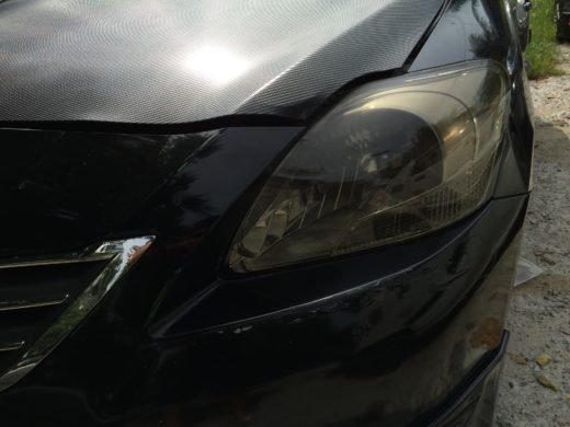 Dented Toyota Vios bumper and headlamp
