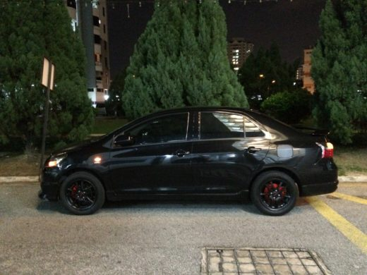 Toyota Vios GT Street with Black TRD Wheels Sideview during Night Time