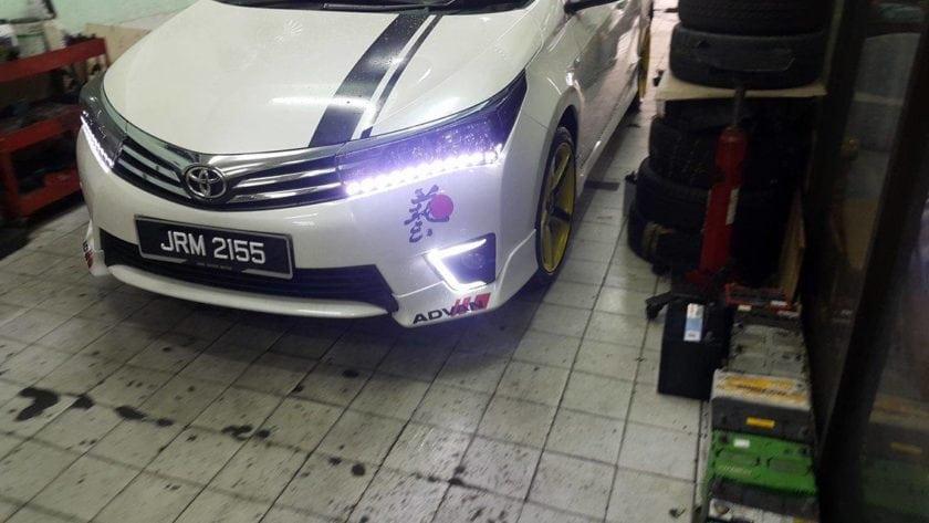 White Toyota Corolla Altis DLR