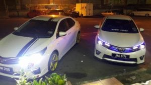White Toyota Corolla Altis by Wai Kit
