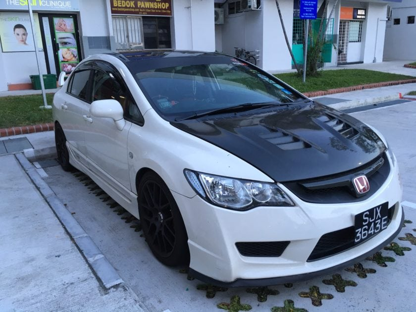 White Honda Civic 8th Generation with Body Kit and Sport Rims