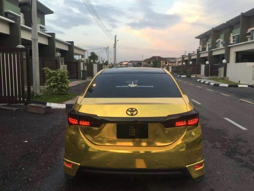 Backview of Gold Toyota Altis