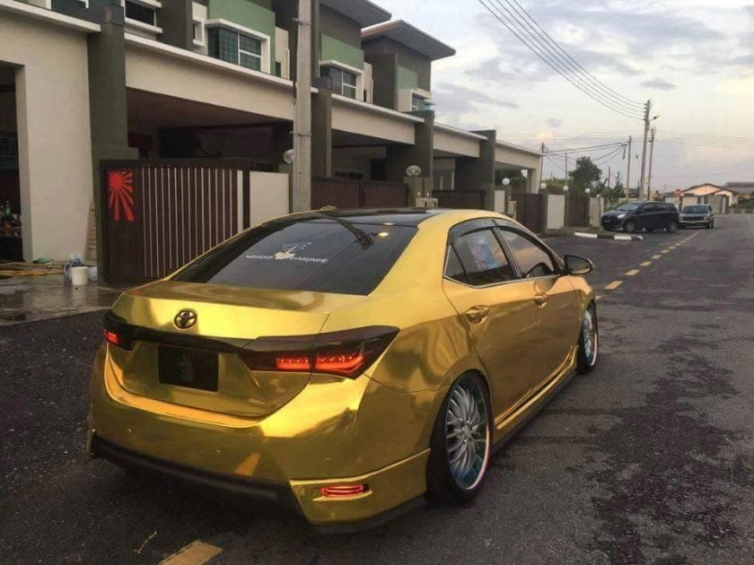 Back view of Gold Toyota Altis