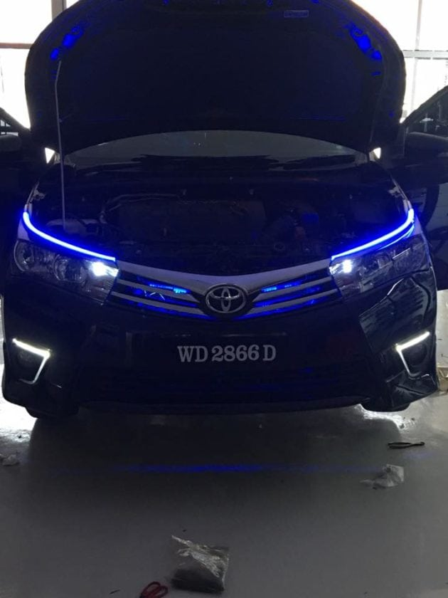 Front view of Black Toyota Altis with Blue DLR LEDs